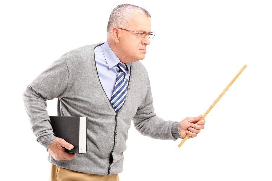 bigstock-An-angry-mature-teacher-holdin-45376279.jpg
